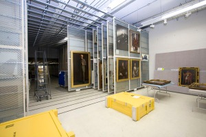 Photograph of the interior of the art storage vault for paintings and other artwork.