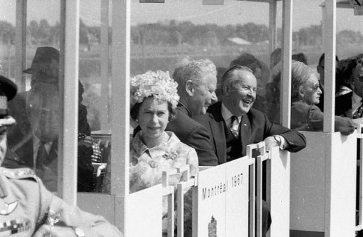 Black and white photograph of Her Majesty Queen Elizabeth II and Prime Minister of Canada Lester B. Pearson in the minirail at Expo 67