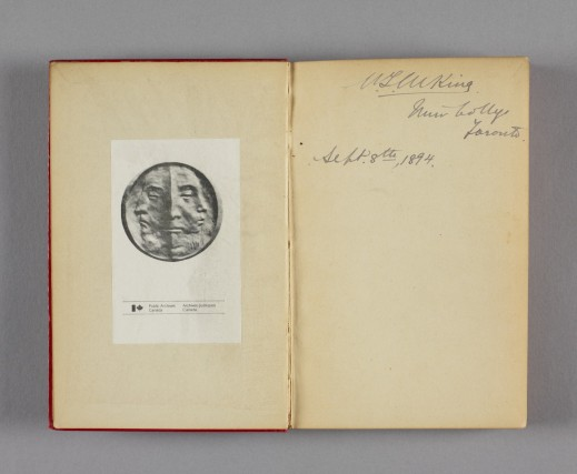 Coloured photo of a book's front inside cover, with William Lyon Mackenzie King's inscription dated September 8, 1894 on the right page. The opposite page has a Public Archives Canada/Archives publiques Canada book plate.