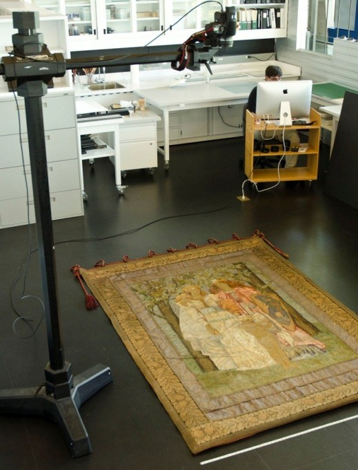 The camera is positioned above the banner, which is laid on the floor.