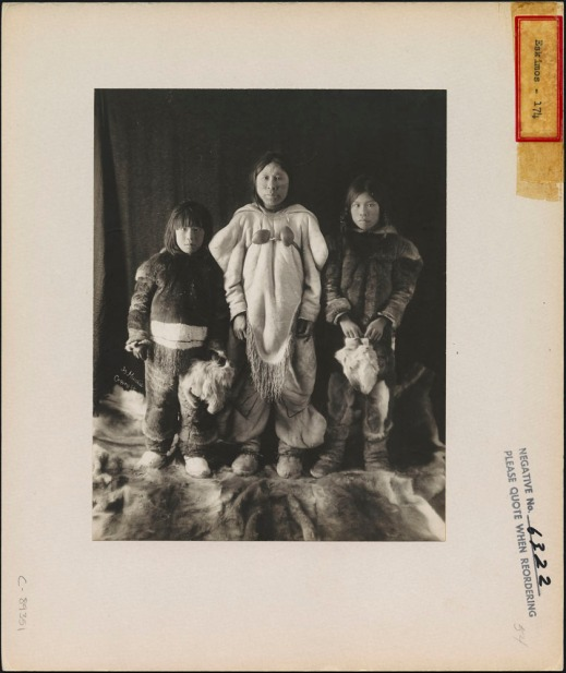 Widow and her children, Nunavut, by Geraldine Moodie.
