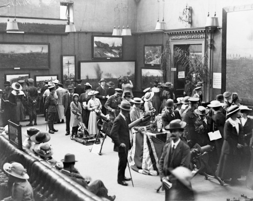 Princess Christian among others viewing images at the Second Exhibition of Canadian Battle Pictures, Grafton Galleries, London, July 1917 (MIKAN 3394829)