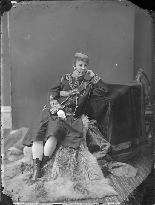 "Miss Minnie Smart dressed as a ""vivandière,"" originally a type of female auxiliary in the French army who sold food and drink to the soldiers."