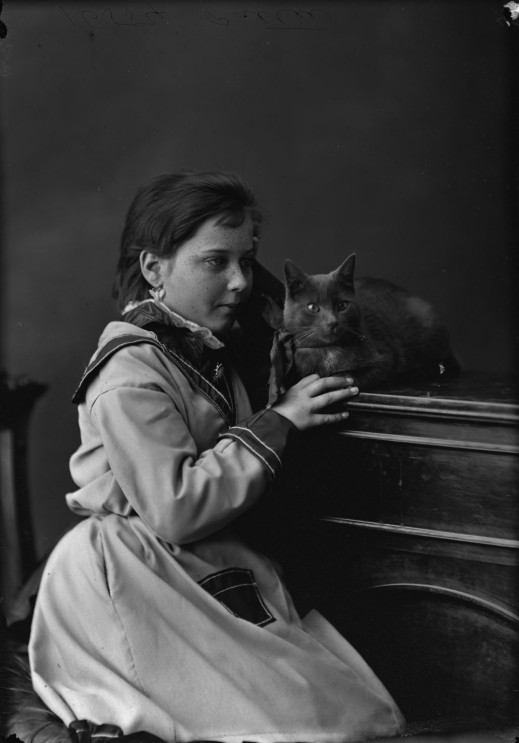 Miss E. Pattie and cat, 1873