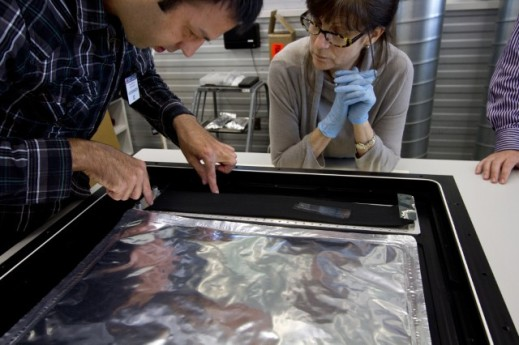 Conservators fitting the interior of the case with an an activated carbon cloth which filters the air, absorbing atmospheric pollutants.