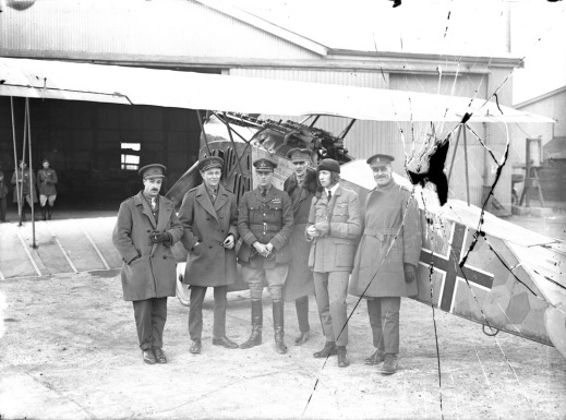 Major W. G. Barker, VC, (5th from left) with captured Fokker D.VII aircraft at Hounslow Aerodrome, April 1919.