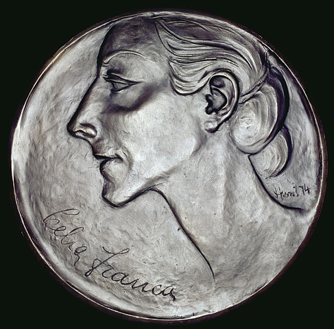 "Photograph of a bronze medal showing the profile of a woman and the inscription ""Celia Franca"" along the bottom left."