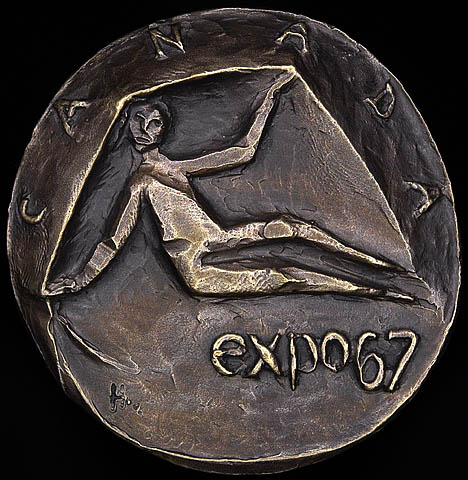 "Photograph of a bronze medal showing a stylized image of a person sitting down, inscribed with the words ""Canada"" along the top edge and ""expo 67"" on the bottom right."