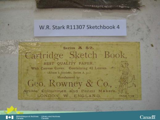 Colour photograph of a yellow label with information on the maker of the sketchbook.