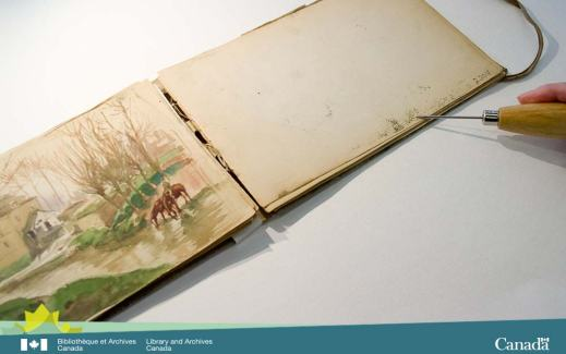 Colour photograph of an open sketchbook showing a watercolour on the left and the transferred media on the right