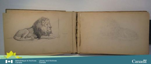 Colour photograph of an open sketchbook. On the left page is a sketch of a lion which has transferred to the right page.