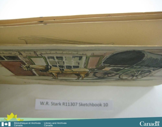 Colour photograph of a sketchbook taken from above showing the ink stains along the page edges