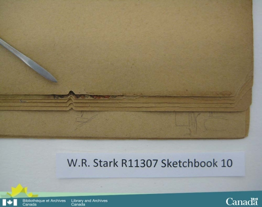 Colour photograph of a sketchbook showing the repetitive, triangular-shaped area of paper that is missing from multiple pages.