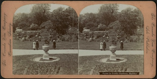 Black-and-white stereograph of three small children standing on a pathway in Halifax's Public Gardens.