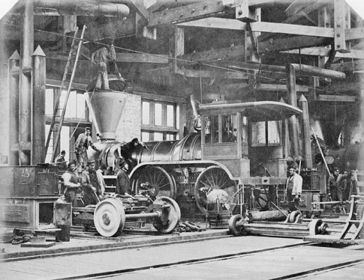 Black-and-white photograph showing a locomotive under construction.