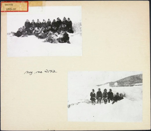 Two black-and-white photos mounted on an album page depicting two groups of North West Mounted Police personnel outside in the snow