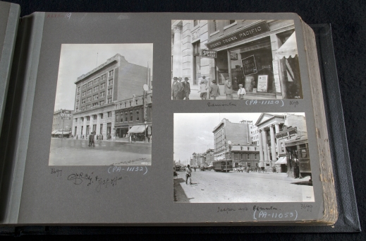 A photograph of an album, showing three black-and-white photographs of a city.