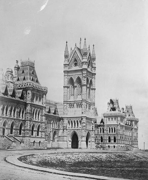 A black-and-white photograph of the original Centre Block on Parliament Hill.