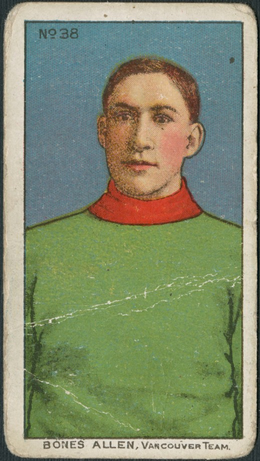 "A trading card with a colour print of a man wearing a plain green sweater with a red collar. It is captioned: ""Bones Allen, Vancouver Team."""