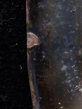 A close-up detail of the plate mark found on the portrait entitled The Three Ladies of Saint-Ours