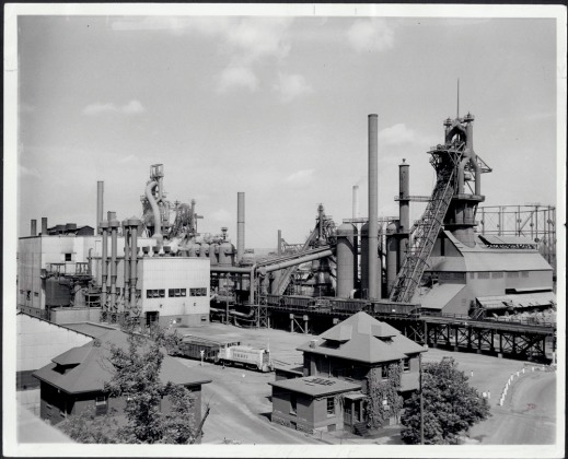 Black and white photograph showing a close-up of blast furnaces on an industrial site.