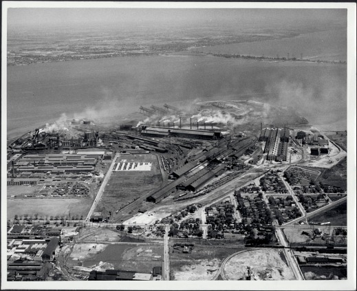 Black and white photograph showing an industrial complex for steel production and processing.