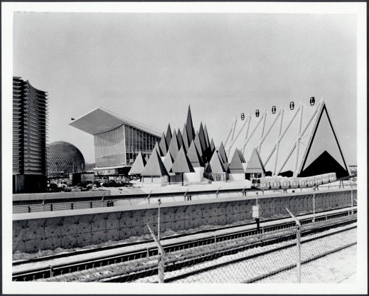 Black and white photograph showing several modern architectural structures.