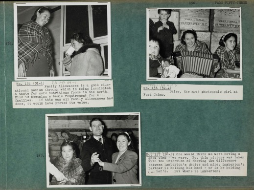 Photograph of a green album page with three black and white photographs (numbered 154, 156, and 157) with typed captions on white paper. The photograph in the top left corner is of an Inuit woman in a plain dress and plaid shawl standing on a porch with a little girl in a parka drinking glass of milk. The photograph in the top right corner is of two Inuit women in plaid shawls and flower headbands sitting in front of wooden crates, one holding an accordion, with a baby sitting in the foreground to the left and a little boy in dress clothes standing beside the woman with the accordion. The photograph at the bottom of the page is of a woman in a blazer and ribbon headband dancing with a man in a suit; the woman on the left is holding a man's hand – the rest of the man is out of the shot – and there are three women and an oil lamp in the background.