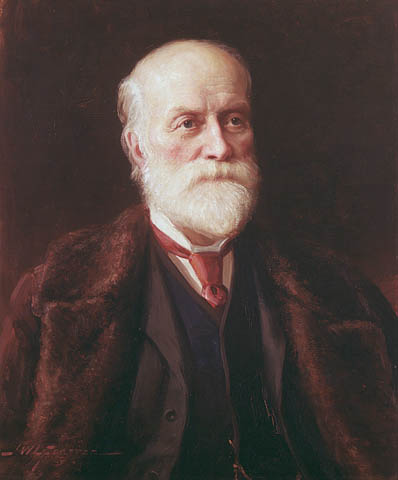 An oil painting of an older man with a white beard wearing a dark suit with a red cravat and a brown fur coat.
