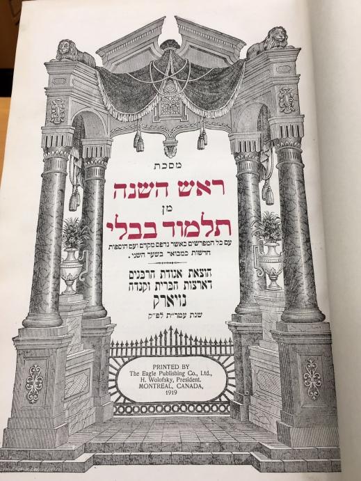 A colour photograph of an open book showing Hebraic writing.