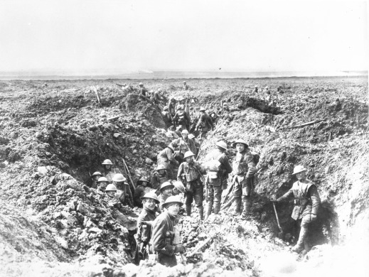 A black-and-white photograph of a group of soldiers working on an earthen trench, digging and consolidating their position.