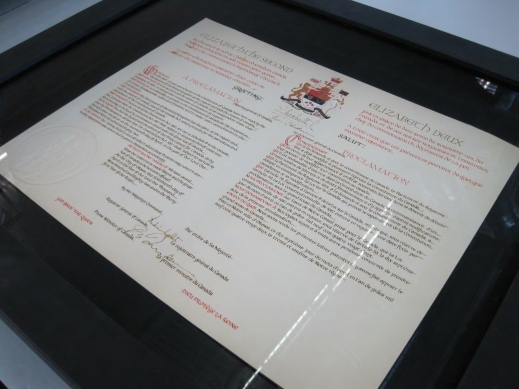 Close up of the preservation case displaying a copy of the Proclamation under glass in a black frame.