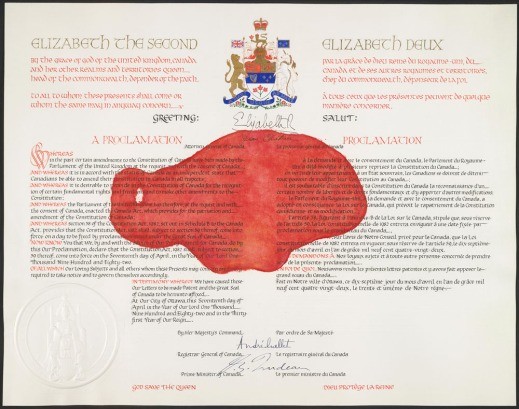 Copy of the Proclamation of the Constitution Act, 1982 with a large red splotch in the middle.