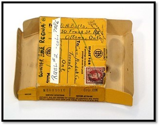 A colour photograph of a yellow film package with writing identifying the film.