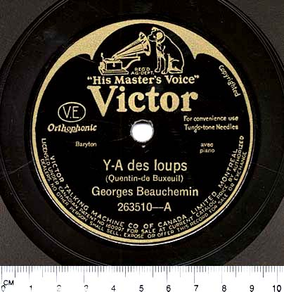 "A colour photograph of a black circular label at the centre of a 78-rpm disc. Gold lettering reads: ""His Master's Voice. Victor. Y-A des loups (Quentin-de Bexeuil). Georges Beauchemin. 263510-A."""