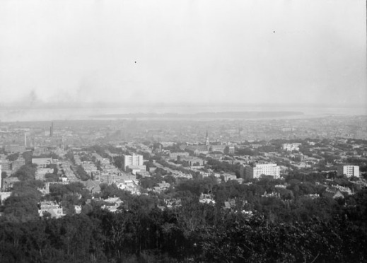 A black-and-white photograph of a bird's eye view of a city.