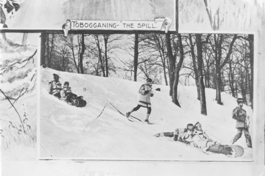 A black-and-white photograph of a winter scene of people on toboggans and others on snowshoes descending a hill.