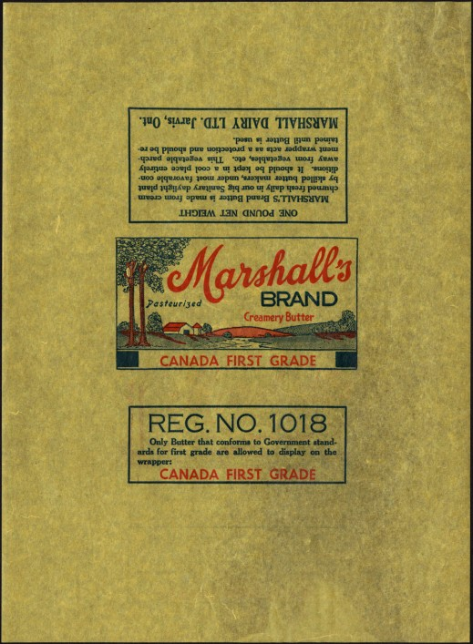 "A colour wax-paper wrapper with a picture of a farm with trees. The text above the image reads: ""Marshall's Brand. Creamery Butter. Pasteurized. Canada First Grade."" Another text box (on the wraparound portion of the paper) reads: ""Reg. No. 1018. Only butter that conforms to Government standards for first grade are allowed to display on the wrapper CANADA FIRST GRADE."""
