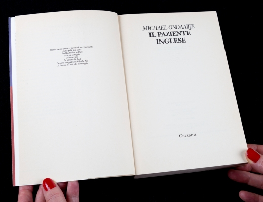 Colour photograph of a book open at the title page: Michael Ondaatje Il Paziente Inglese.