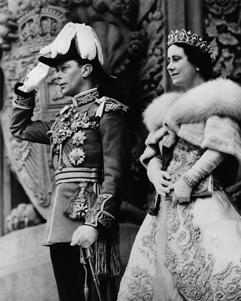 A black-and-white photograph of saluting King George VI beside Queen Elizabeth outside the Parliament Buildings of Canada.