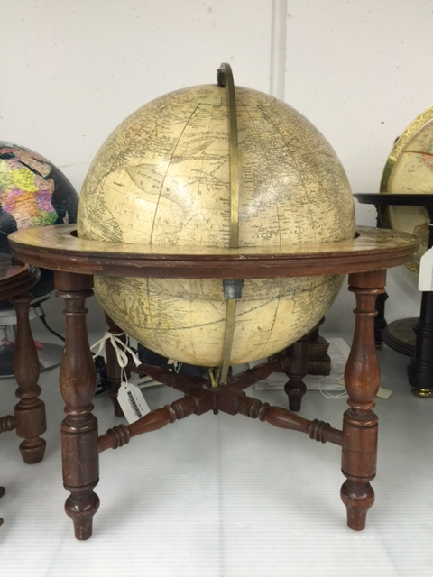 A large globe in a wood and brass stand.