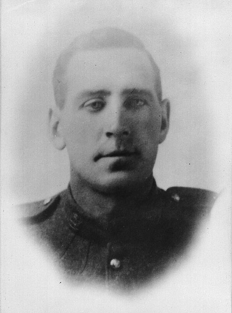 A black-and-white photograph of a young man in uniform.