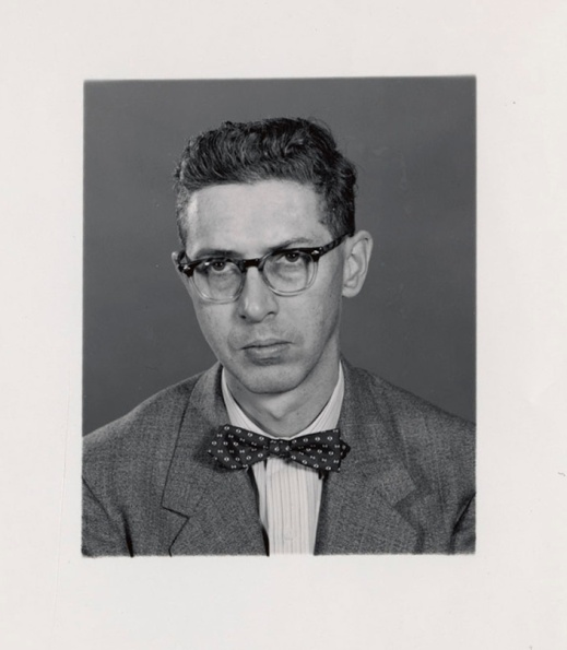 Black-and-white photograph of a young man wearing glasses and a bowtie.