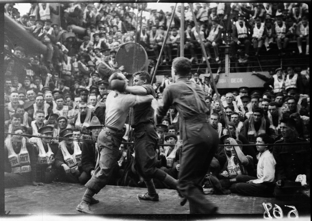 a405786a4ba A black-and-white photograph of two boxers fighting on the deck of the