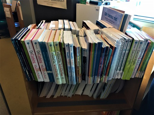 Colour photo of a book cart with two copies of each book.