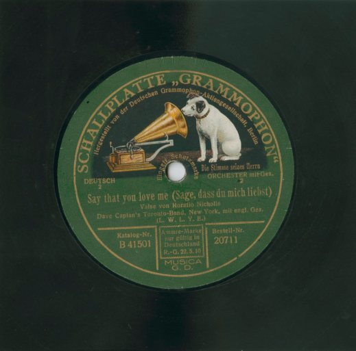 A colour photograph of a record label with the Deutschen Grammophon logo of a dog peering into a record player horn.