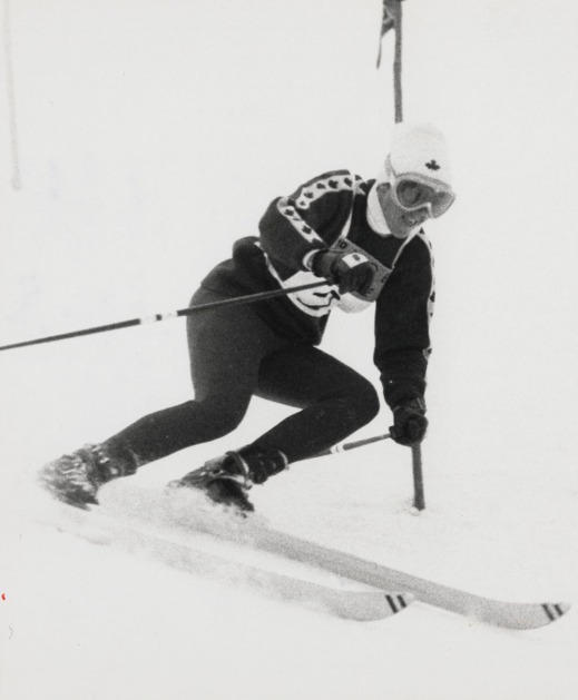 A black-and-white photograph of Nancy Greene during her silver medal run in slalom.