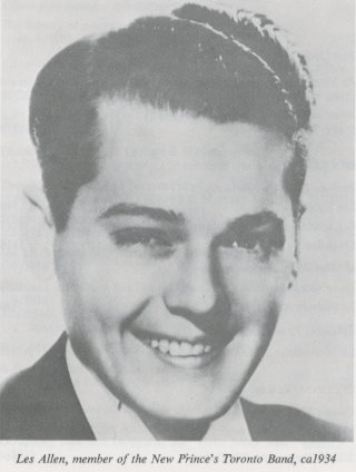A black-and-white photograph of a young man smiling.