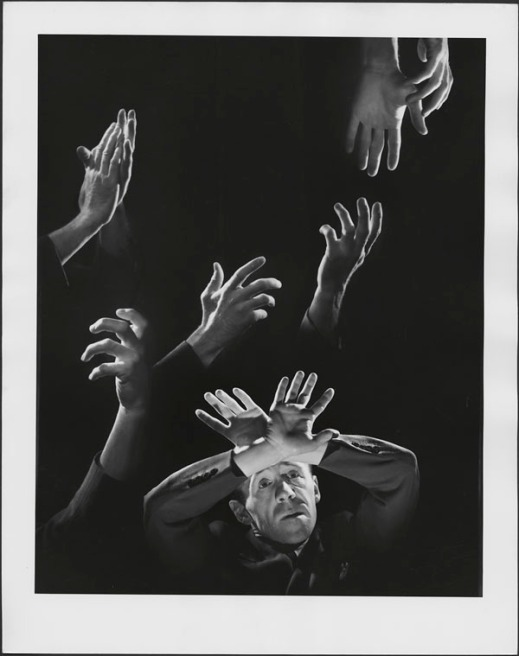 Black-and-white composite photograph showing Gratien Gélinas's expressive hands in various poses. The bottom of the image shows a man looking up at his hands crossed over his head.