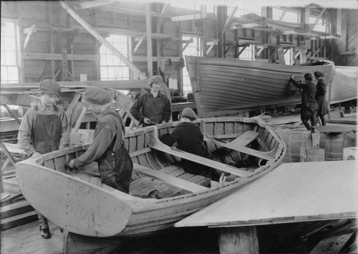 A black-and-white photograph of six women working on prototype boats at Dr. Alexander Graham Bell's laboratory.